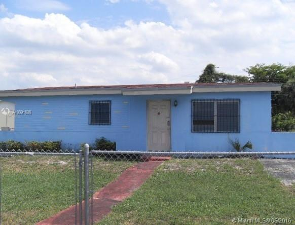 Photo of home for sale at 2500 206th St NW, Opa-Locka FL