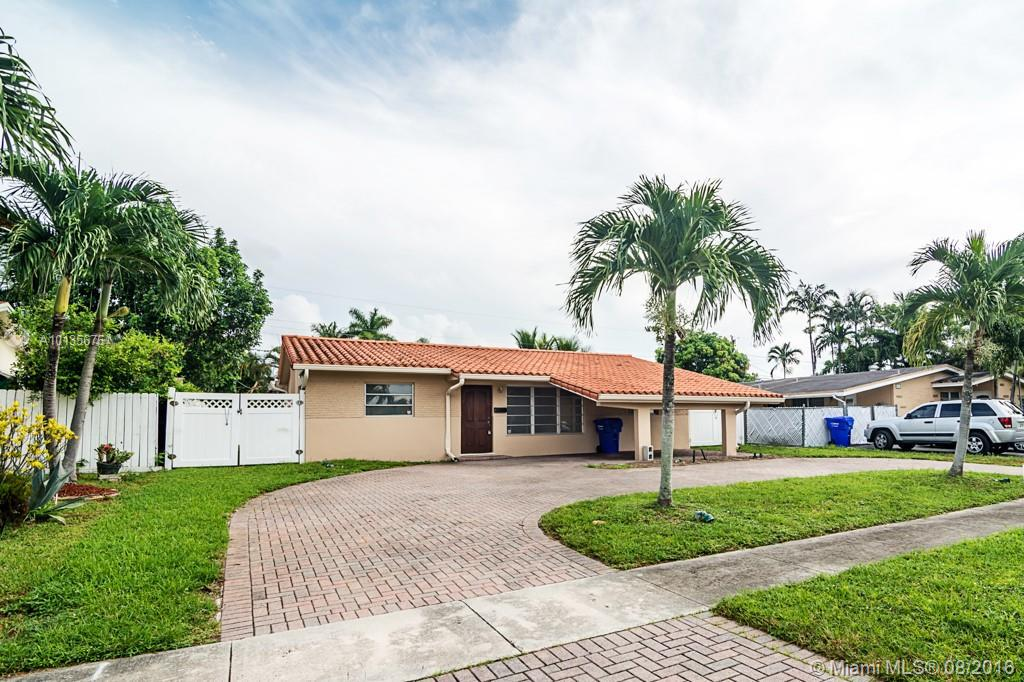 Photo of home for sale at 6561 Coolidge St, Hollywood FL