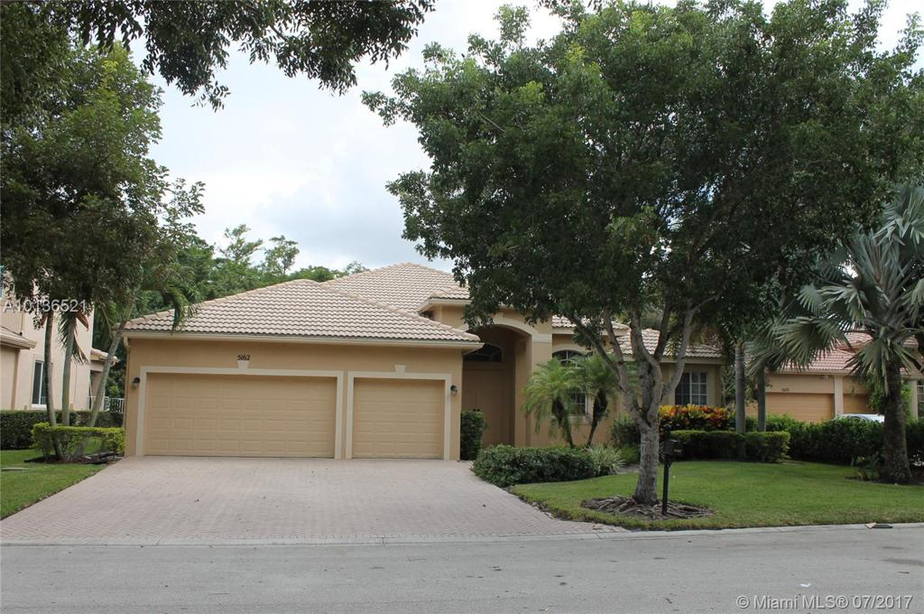 Photo of home for sale at 5162 74th Ct NW, Coconut Creek FL
