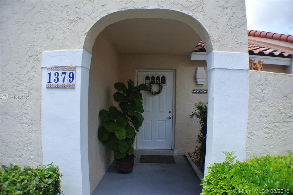 Photo of home for sale at 1379 Cottonwood Cir, Weston FL