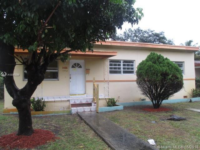 Photo of home for sale at 1075 145th St NE, North Miami FL