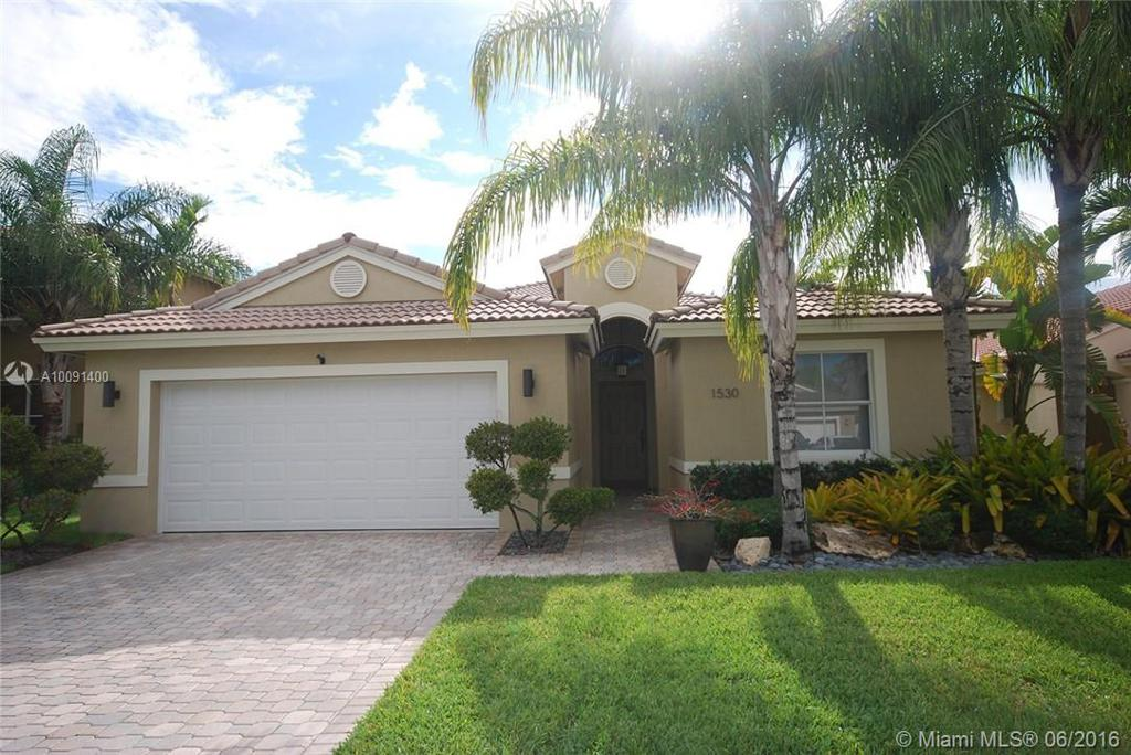 Photo of home for sale at 1530 187 terrace SW, Pembroke Pines FL