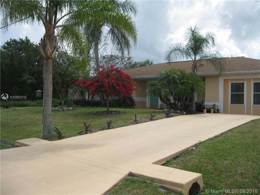 Photo of home for sale at 1326 Sultan SW, Port St. Lucie FL