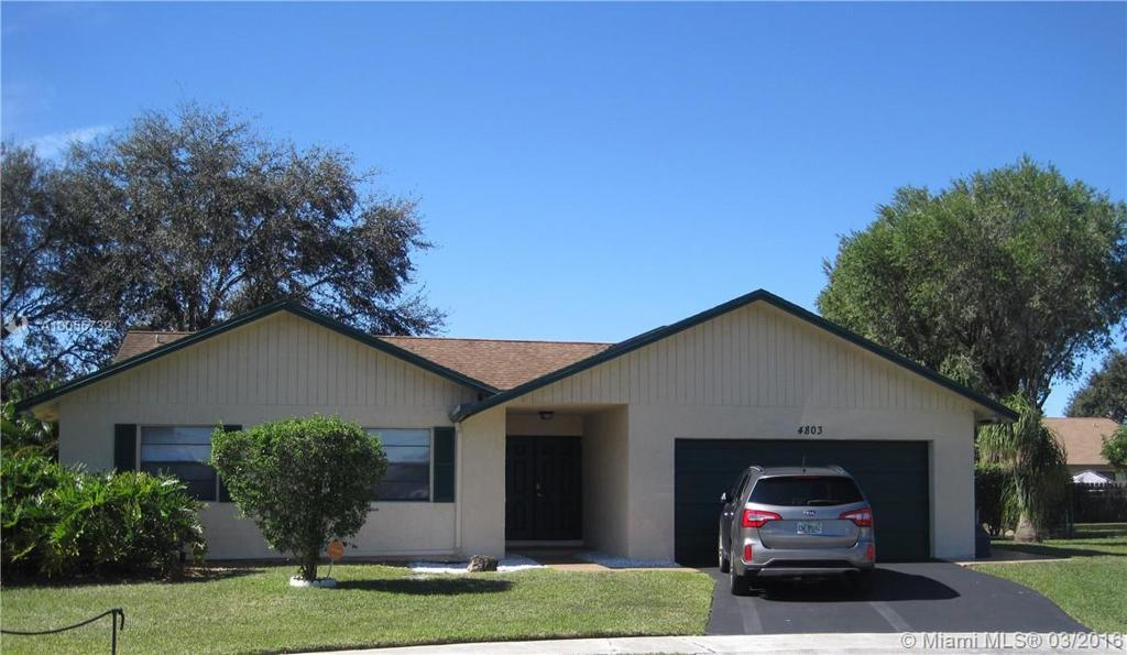 Photo of home for sale at 4803 92nd Ave NW, Sunrise FL