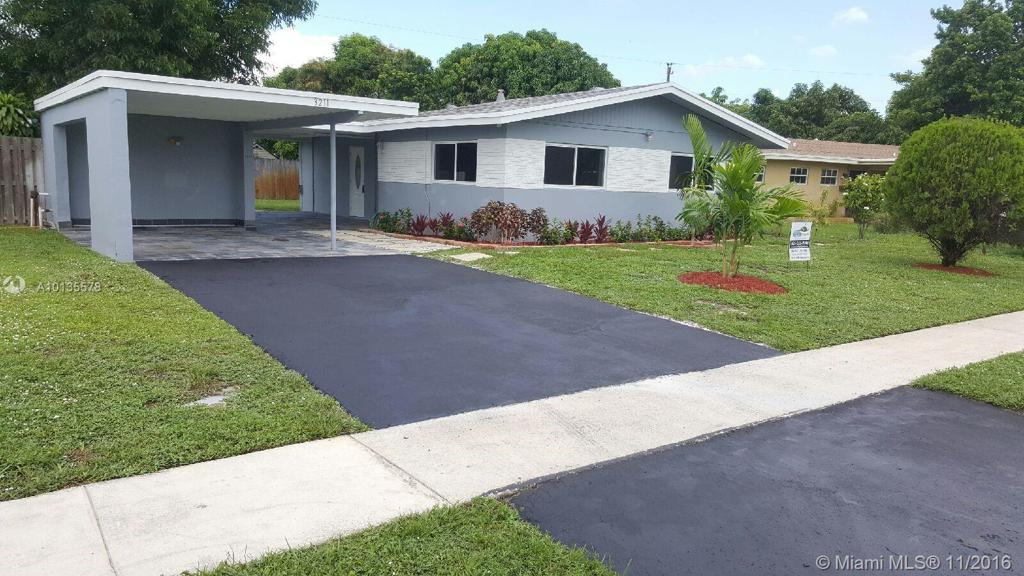 Photo of home for sale at 3211 45th Ter, Lauderdale Lakes FL