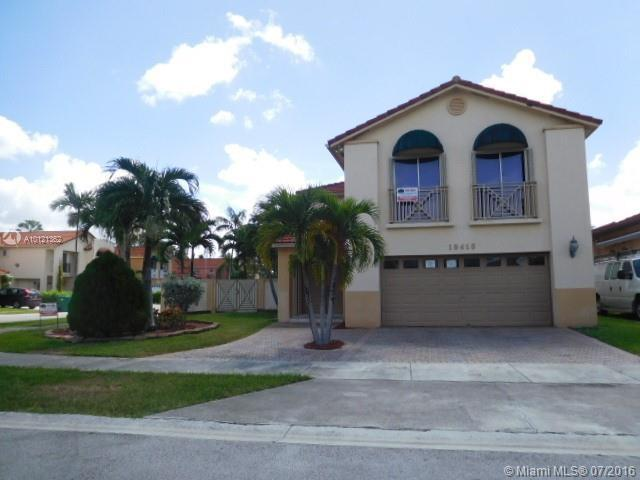 Photo of home for sale at 19415 82 Pl NW, Hialeah FL