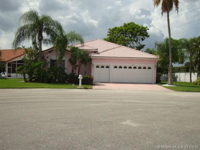 Photo of home for sale at 7605 87 Way NW, Tamarac FL