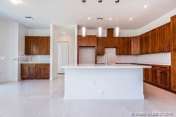 Photo of home for sale at 8215 188 SW, Cutler Bay FL