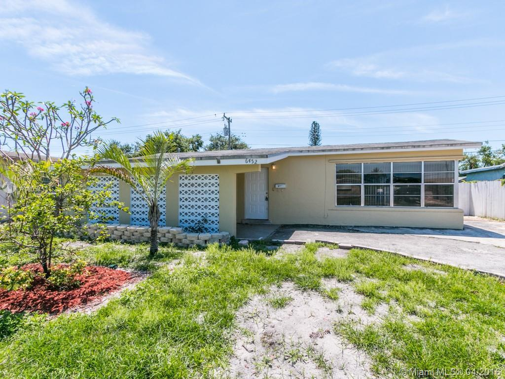 Photo of home for sale at 6452 Evans St, Hollywood FL