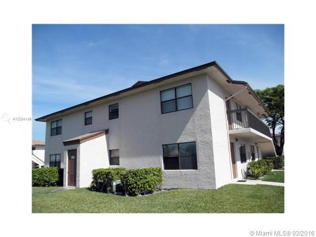 Photo of home for sale at 10057 Winding Lake Rd, Sunrise FL