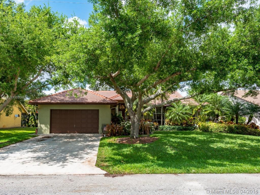 Photo of home for sale at 11921 24th St NW, Plantation FL