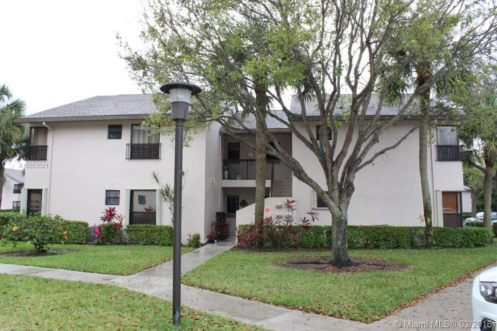 Photo of home for sale at 3310 47th Ave NW, Coconut Creek FL