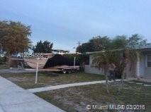 Photo of home for sale at 3920 32nd Blvd SW, West Park FL