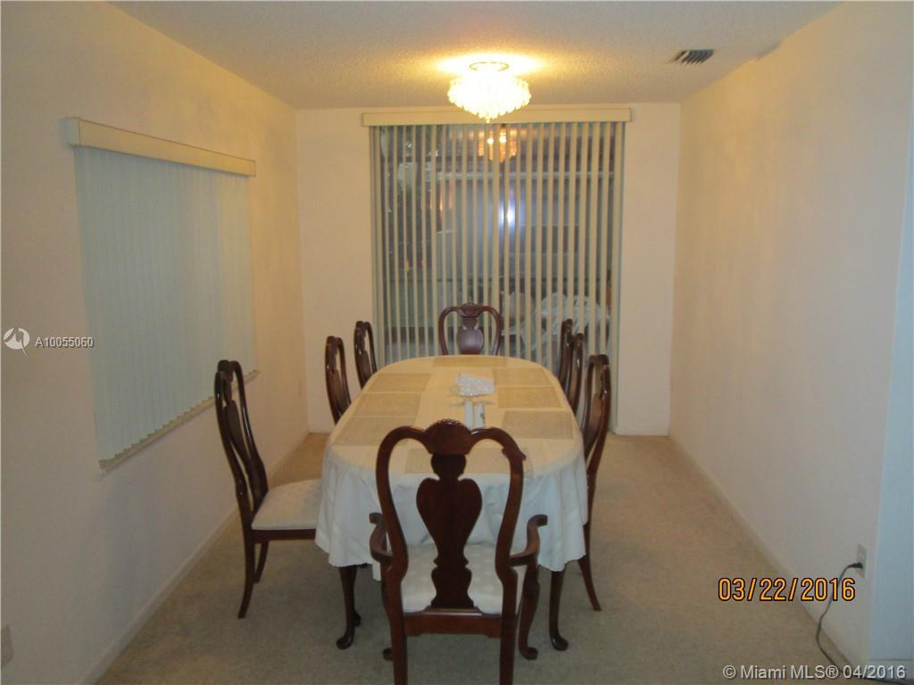 Photo of home for sale at 11778 1st St NW, Coral Springs FL