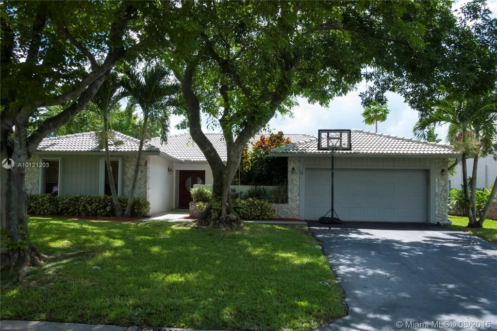 Photo of home for sale at 447 105 Drive NW, Coral Springs FL