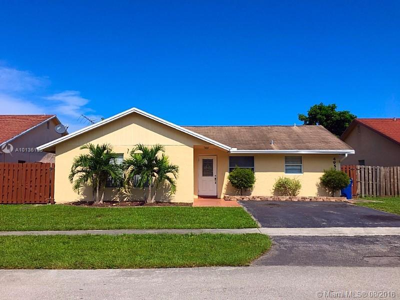 Photo of home for sale at 4952 92nd Ave NW, Sunrise FL