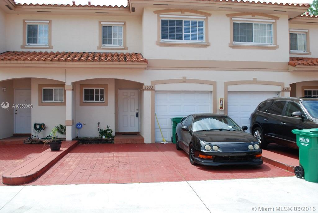 Photo of home for sale at 3053 Riverside Dr, Coral Springs FL