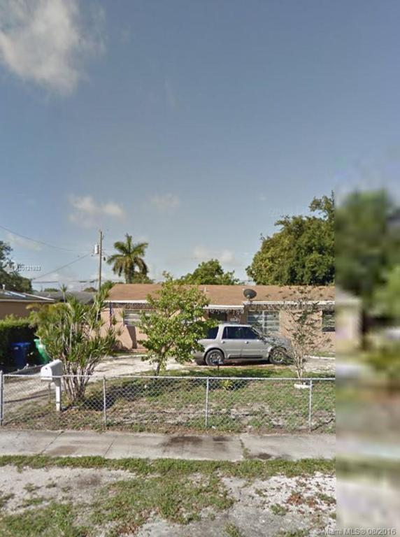 Photo of home for sale at 9170 32nd Court Rd NW, Miami FL
