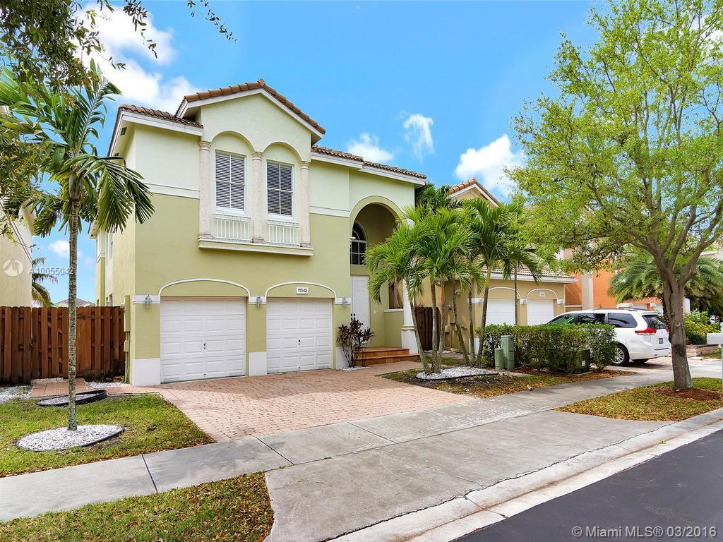 Photo of home for sale at 11342 47th Ln NW, Doral FL