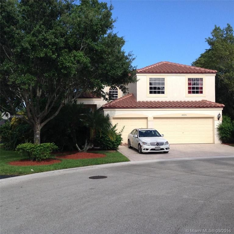 Photo of home for sale at 10474 11th Ct NW, Plantation FL