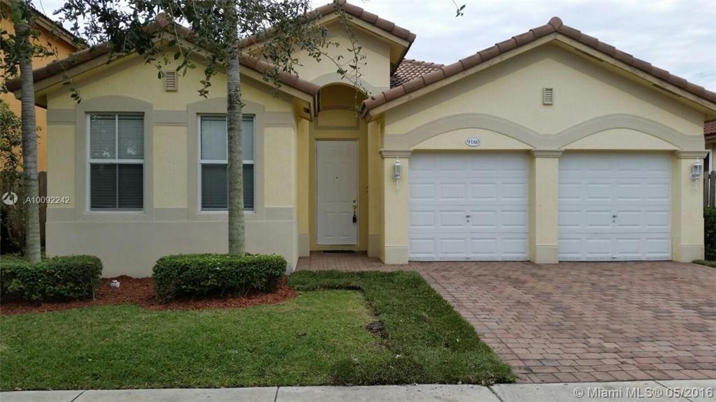 Photo of home for sale at 9160 153 PG SW, Miami FL