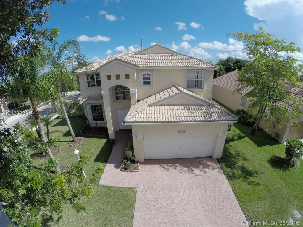 Photo of home for sale at 13214 15th Ct NW, Pembroke Pines FL