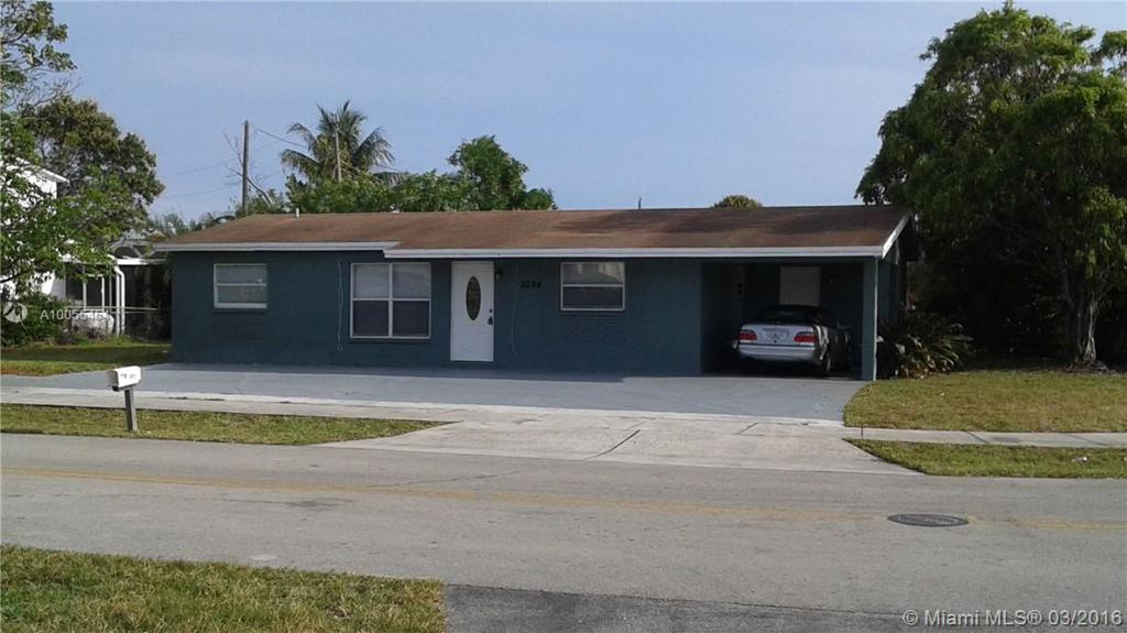 Photo of home for sale at 3594 18th Pl NW, Lauderhill FL