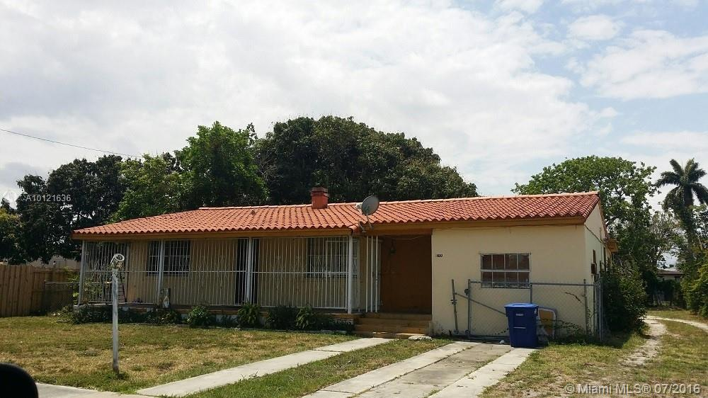 Photo of home for sale at 8820 8th Ave NW, Miami FL