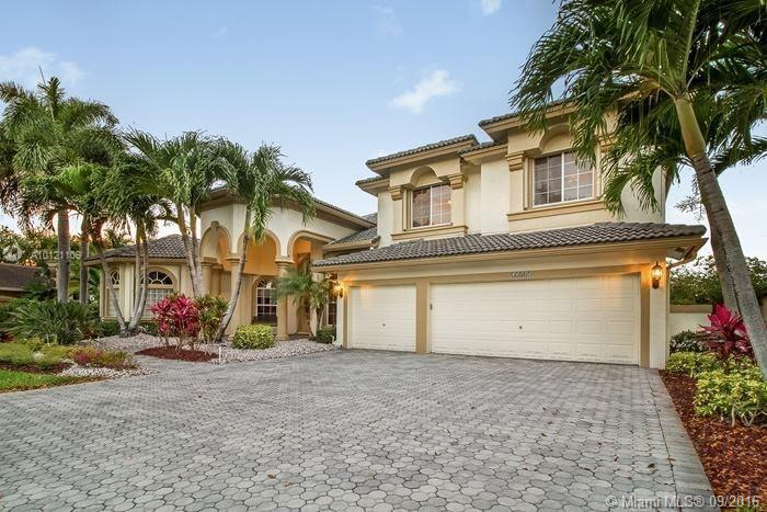 Photo of home for sale at 12805 69th Ct NW, Parkland FL