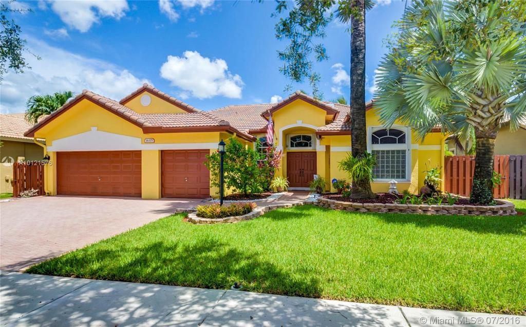 Photo of home for sale at 16375 Mariposa Cir, Pembroke Pines FL