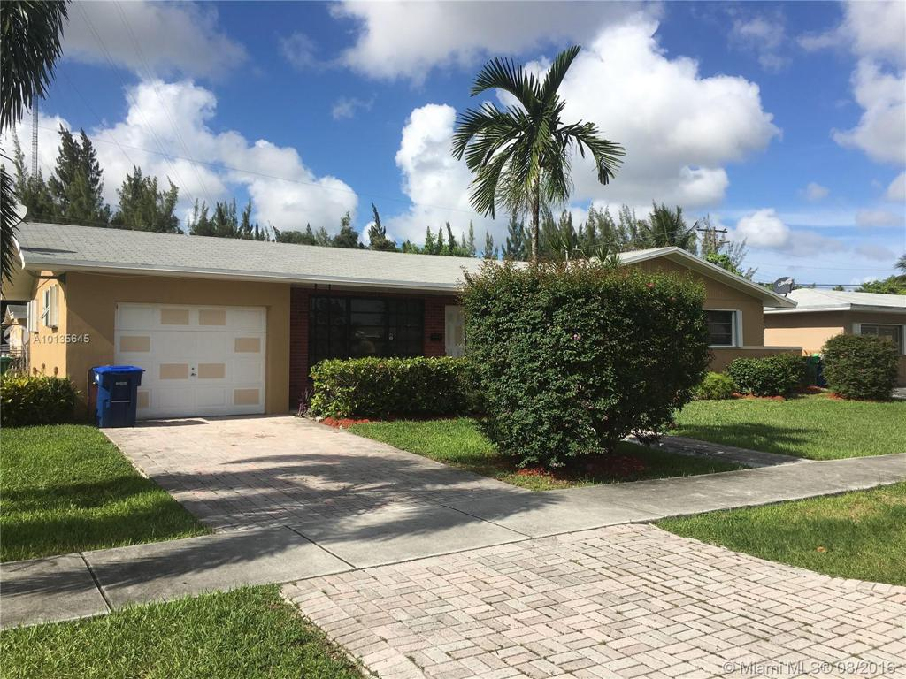 Photo of home for sale at 321 206th Ter NW, Miami Gardens FL