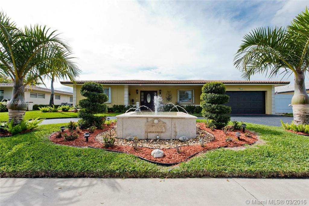 Photo of home for sale at 7010 16th St SW, Plantation FL