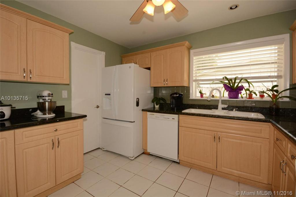 Photo of home for sale at 19210 93rd Rd, Cutler Bay FL