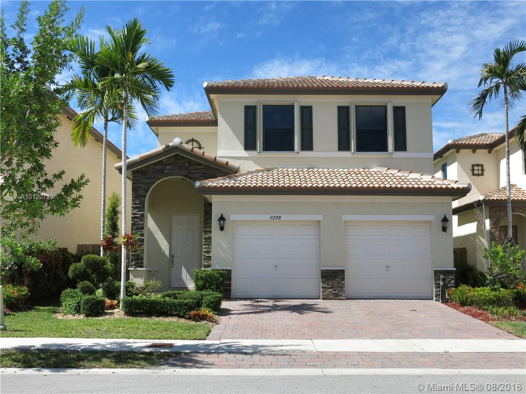 Photo of home for sale at 9208 227th Ter SW, Cutler Bay FL