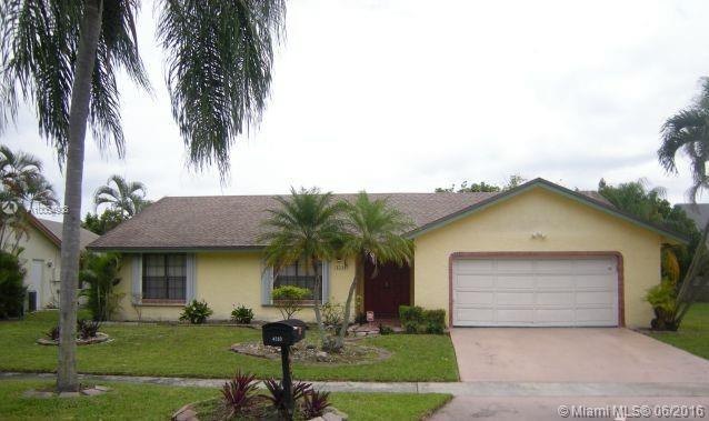 Photo of home for sale at 4510 71 NW, Lauderhill FL