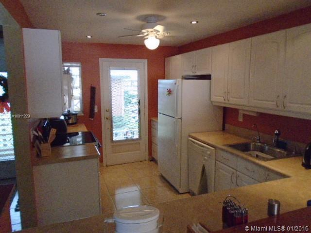 Photo of home for sale at 3051 46th Ave NW, Lauderdale Lakes FL