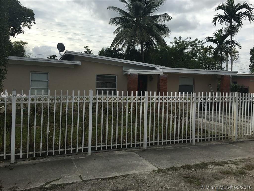 Photo of home for sale at 550 136th St NW, North Miami FL