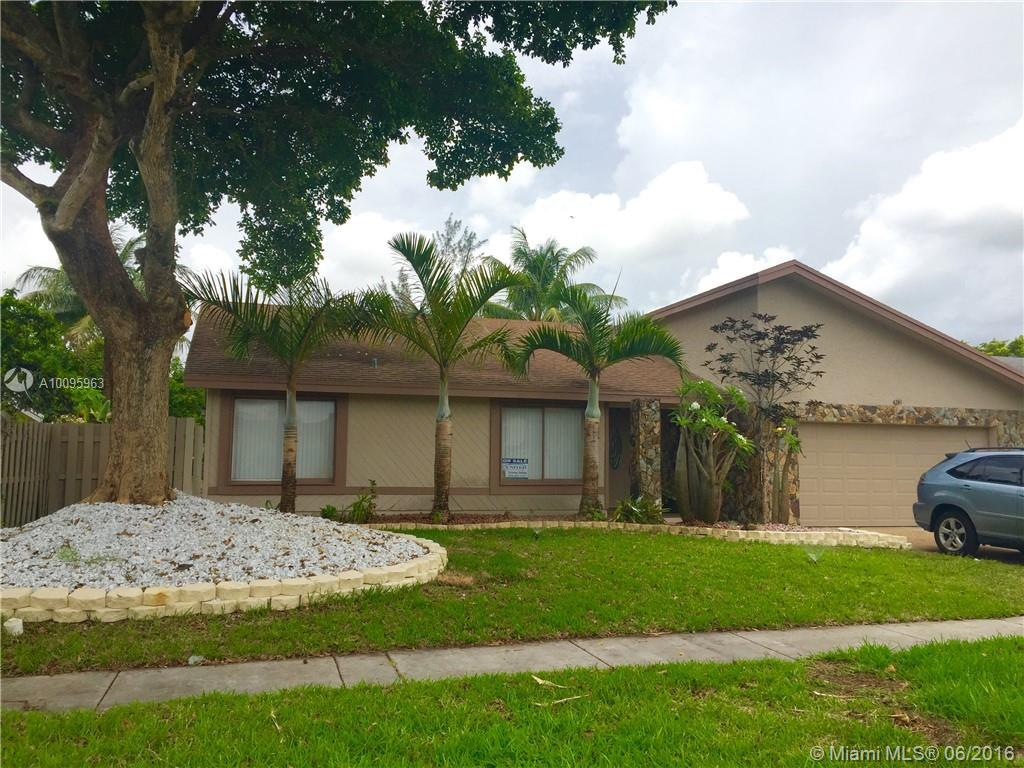 Photo of home for sale at 4241 74th Ave NW, Lauderhill FL