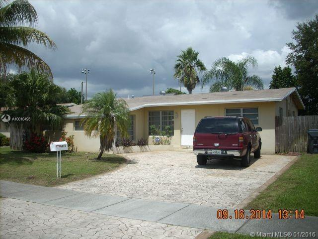 Photo of home for sale at 6871 Douglas St, Hollywood FL