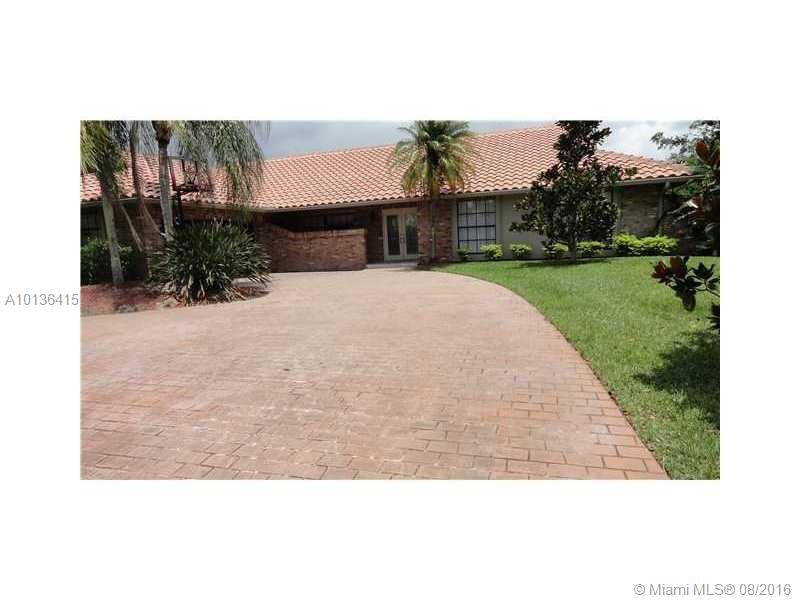 Photo of home for sale at 10499 3rd Pl NW, Coral Springs FL