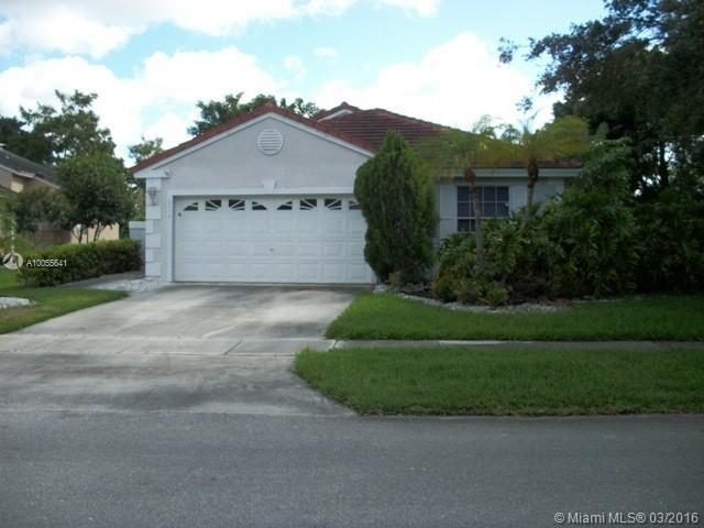 Photo of home for sale at 18010 18th St NW, Pembroke Pines FL