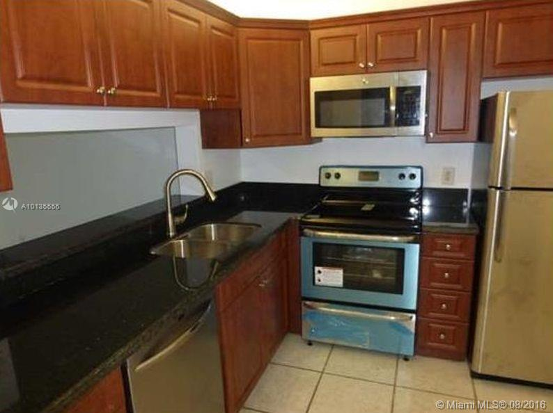 Photo of home for sale at 8770 Royal Palm Blvd, Coral Springs FL