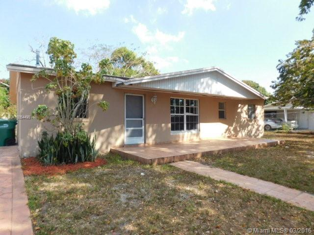 Photo of home for sale at 20421 44th Ct NW, Miami Gardens FL