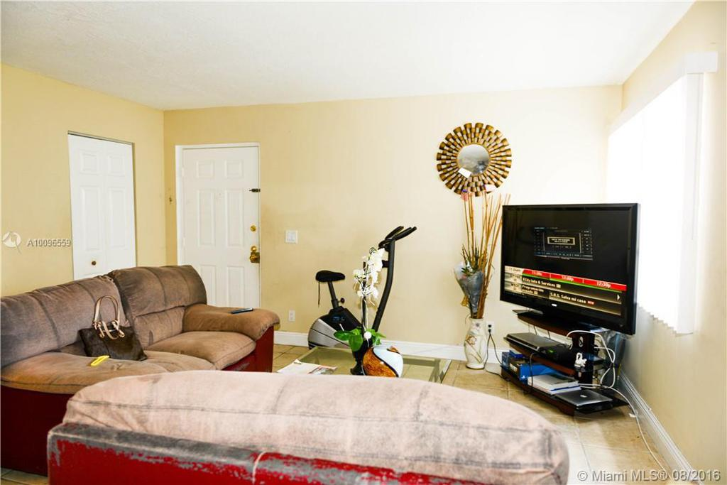 Photo of home for sale at 3037 118th Dr NW, Coral Springs FL