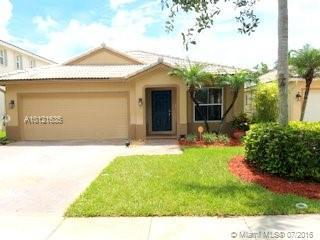 Photo of home for sale at 1433 208th Ter NW, Pembroke Pines FL
