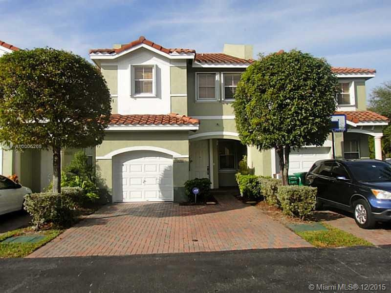 Photo of home for sale at 4374 115 CT NW, Doral FL