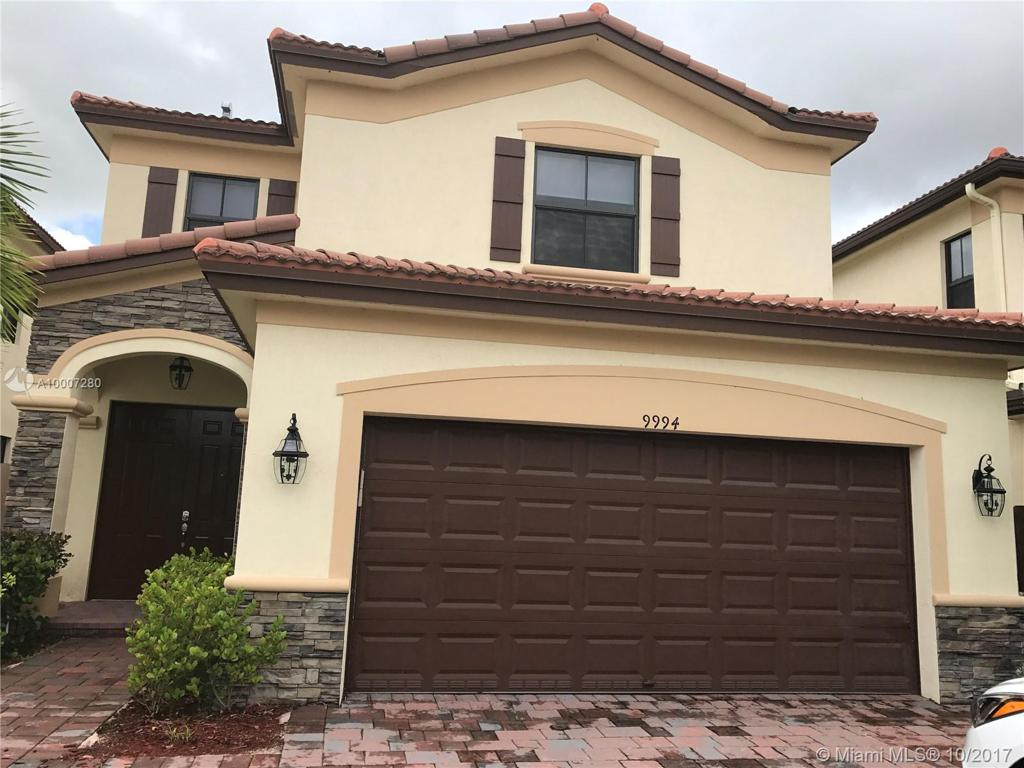Photo of home for sale at 9994 86th Ter NW, Doral FL