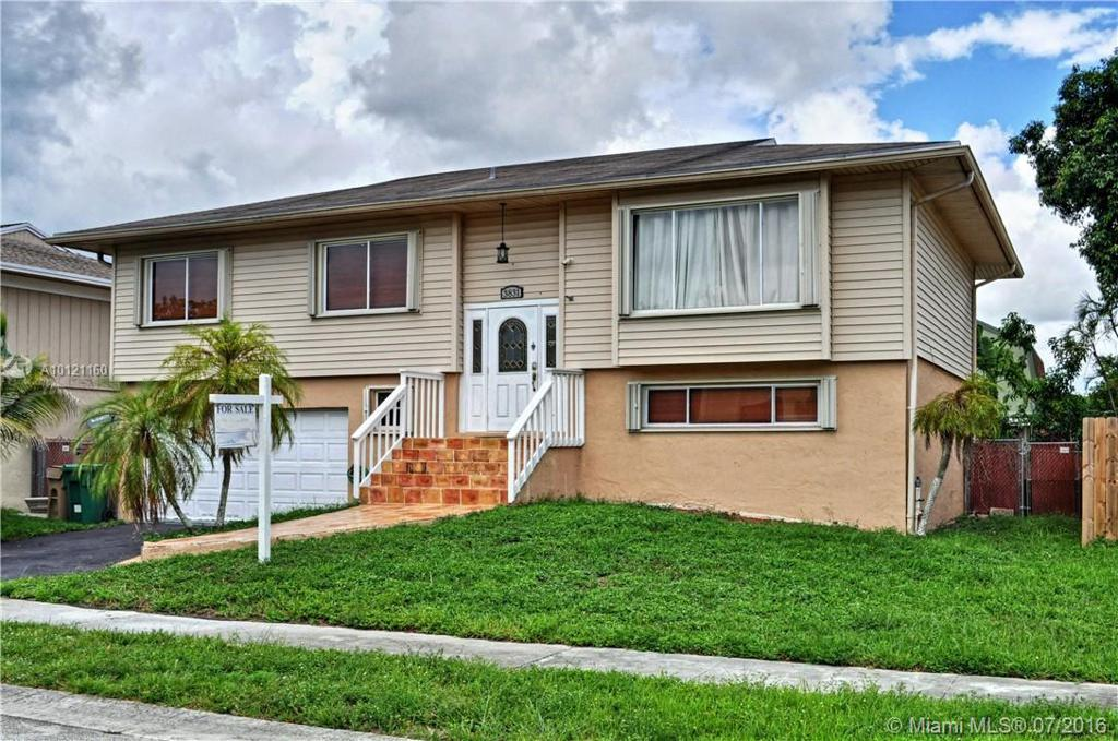 Photo of home for sale at 3831 79th Way NW, Hollywood FL