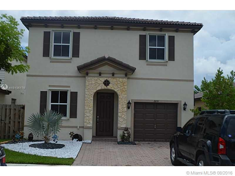 Photo of home for sale at 2474 4th St NE, Homestead FL