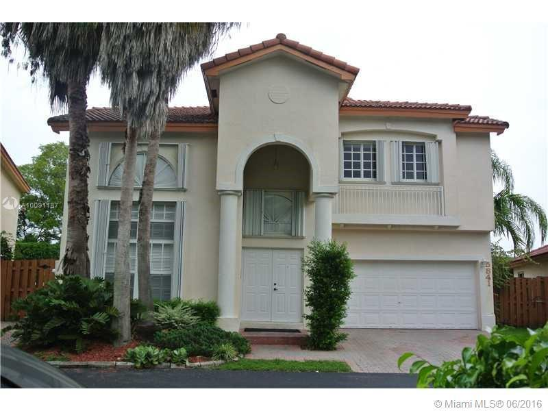 Photo of home for sale at 5841 112th Ct NW, Doral FL